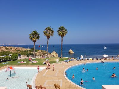 Photo for South facing 2 bed Apartment near to beach with sea view, large pool and garage