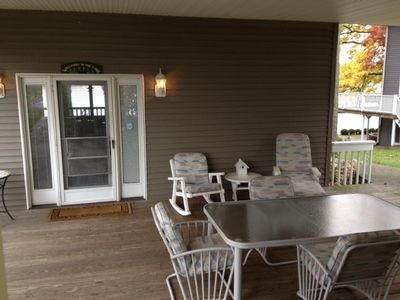 Covered rear porch. Ideal for morning coffee and late night visits.