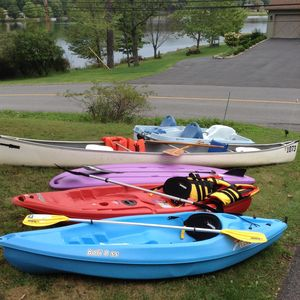2  new kyaks, 1 standup paddle board, canoe, & paddle boat, vests : 2 bikes too