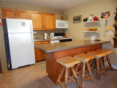 Photo for Cozy unit for a couples getaway - great bedding options, free Wi-Fi and hardwood floors.