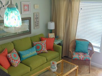 Get cozy in the Beach Chic themed, east side, 2nd floor condo