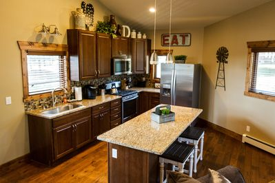 Custom Kitchen with Thomasville Cabinets & Granite Counters. Stainless Gas Stov