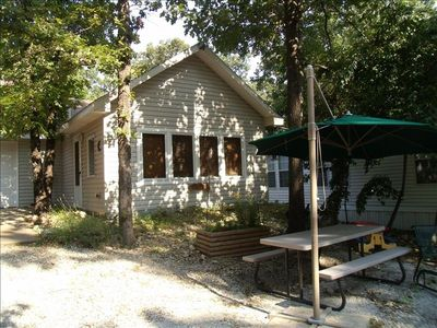 Tree Shaded Cabin with picnic table and fire-pit with lake view.