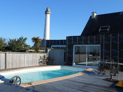 Photo for TREZIEN LE PHARE - Independent apartment with heated pool