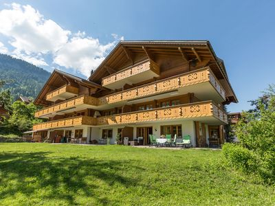 Photo for Luxury apartment on the ground floor in Zweisimmen Ski-in and Ski-out