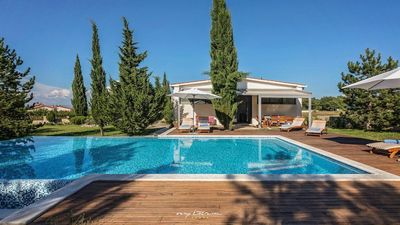 Photo for Elegant villa with pool amidst the countryside
