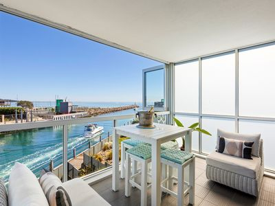 Photo for Azure Bliss - Luxury apartment on the water, heated pool, water views, walk to beach
