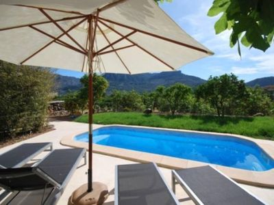 Photo for Village house with a fireplace and swimming pool in Sóller