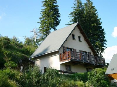 Photo for NICE CHALET IN BESSE in the heart of nature