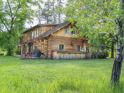 Photo for Idyllic cabin on the river with boats, bikes, horseshoes, and volleyball on site