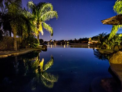 Photo for Lakefront Oasis:Heat included Infinity Pool Spa, Boat Use Included, Putting Gr
