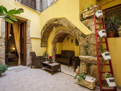 Photo for Peaceful 78sqm flat with private courtyard in Ortigia, historic centre