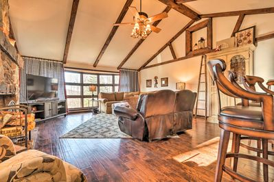 Hardwood floors and exposed beam ceilings welcome you into the living space.