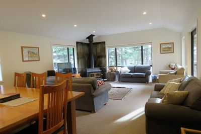The spacious living area complete with log fire