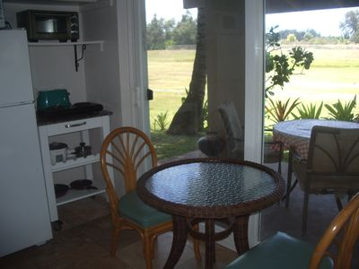 View of porch and meadow from dining area
