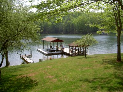 Large Dock with covered area and 32ft floater where you can tie up a rental boat