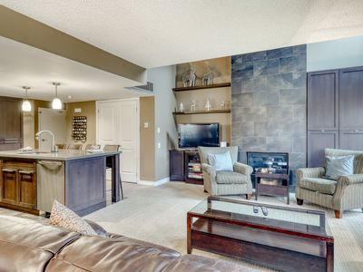 Photo for Spacious open concept condo w/shared swimming pool, small balcony & lawn views!