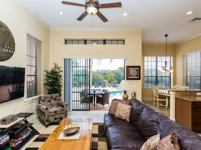Photo for Comfortable, spacious home with game room, extended pool deck & built in BBQ