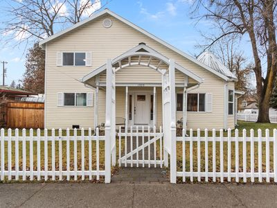Photo for Quaint home w/free WiFi, private hot tub, firepit, & gas grill - walk downtown!