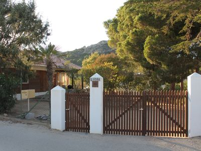 Photo for Old wooden house in Calvi 800 meters from the beach with a large garden