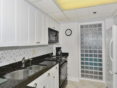 DAILY ACTIVITIES & LINENS INCLUDED*! Direct Oceanfront 2 bedroom (enclosed den converted to a third bedroom with new double bed & pocket door) 2 bath condo.