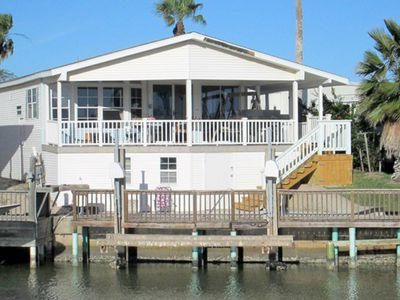 Photo for Waterfront home w/ dock, shaded deck & shared pools/hot tub/tennis/gym!