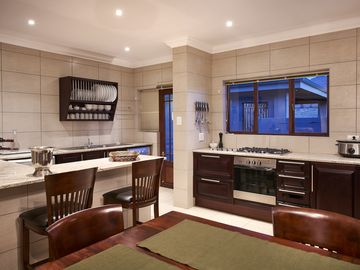 This holiday home has a balcony, stove top and kitchen