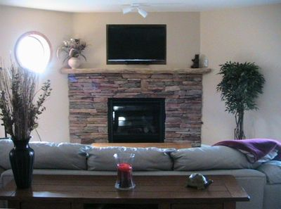 Large, Open Living Room Area with leather Sofa and Lazyboy