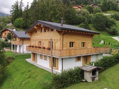 Photo for A luxury 14 person chalet with sauna, 250 metres from the ski run.
