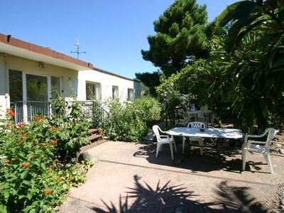 Photo for 10 minutes from the beach 70m2 apartment in a house, sleeps 4, quiet, garden, garage