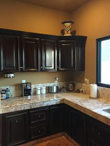 Kitchen with spice rack and coffee pot