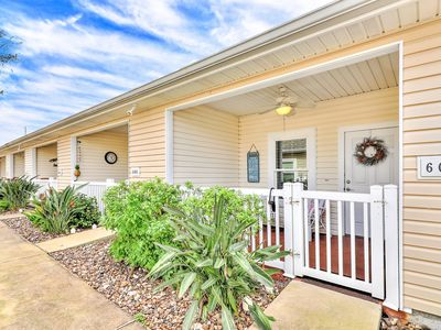 Photo for Dog-friendly townhome w/ covered patio & shared pool - close to the beach!