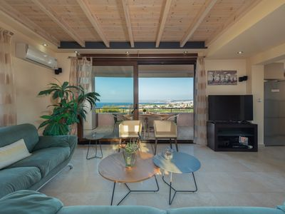 Photo for Hill top villa with magnificent sea views, close to the beach and centrally located
