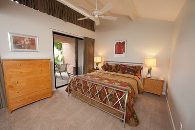 Master Suite featuring king sized bed and view of lake.