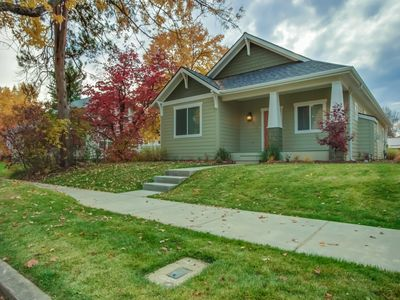 Photo for Charming home w/ a fireplace, porch, & lawn - walk to the lake!