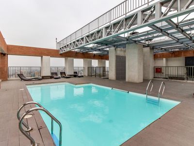 Photo for Urban apartment w/ a shared pool, BBQ area, fitness gym & more. Walk everywhere!