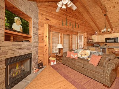 Photo for Cozy 5 star rated  log CABIN**HOT TUB**King Bed **Free Wifi and river access**