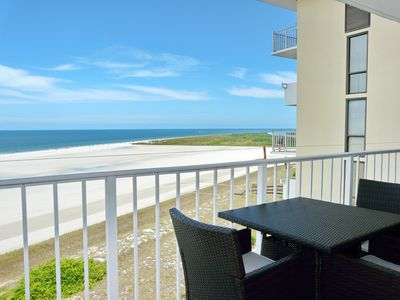 Photo for Tranquil beachfront condo w/ western exposure & heated pool