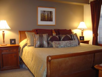 Designer decorated bedroom with King Bed & Curtains