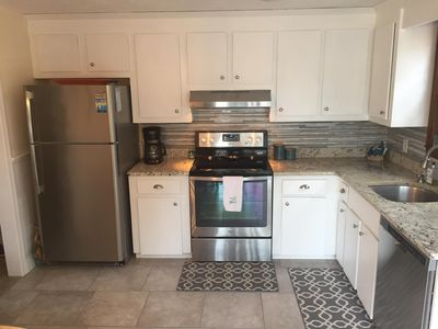 Updated kitchen with brand new tile floor, paint and granite counter tops.