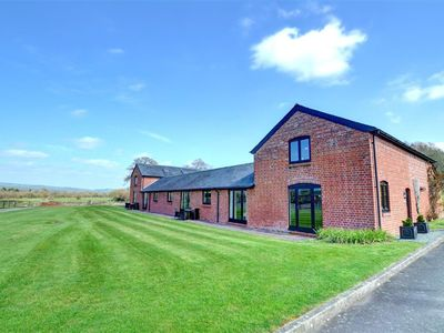 Photo for In a newly refurbished row of cottages, Y Stabl is a two storey property on the end and offers a lit