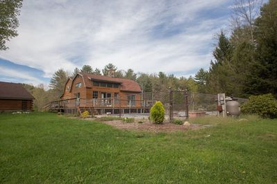 Listing is behind main house and overlooks the in-ground pool.