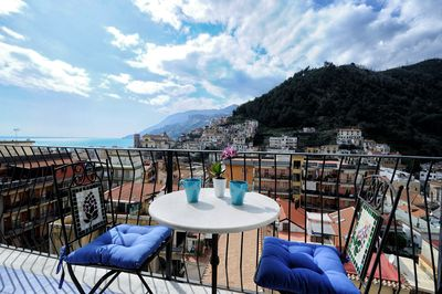 Balcony overlooking the  mountains, the city and the sea