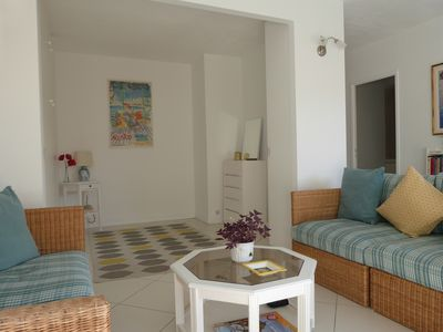 Photo for Stylish studio with sunny balcony on seafront with air con, wifi, rooftop pool.