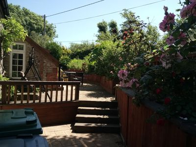 Steps up to outside dining area and swing seat