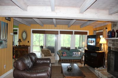 Comfortable setting with views from most rooms.  Plenty of seating on porches to