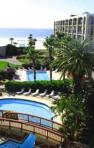 Photo for 2 Bedroom 2 Bath Condo with Pool View steps away from the Beach.