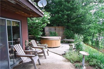 Just steps from the master bedroom, your hot tub overlooks the marsh