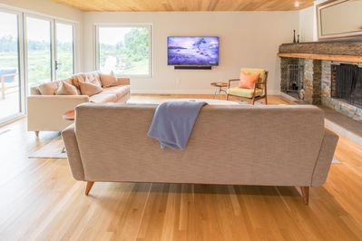The family room has a wood-burning fireplace and queen-sized pull out couch