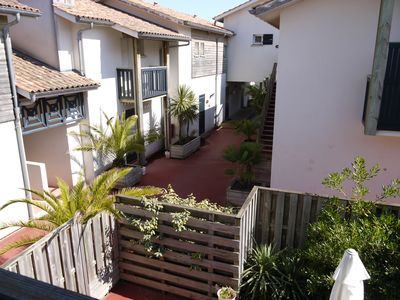 Photo for Apartment duplex with a large patio- Cap ferret- centre of the village